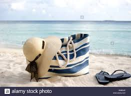 flip flop bag bag flip flops and sun hat in the in maldives stock