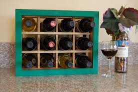 custom small space handmade wine rack with green painted frame by