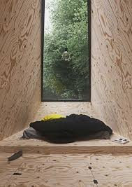 a cabin in the forest by tomek michalski ignant com