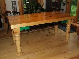 knotty pine table legs compliment table flooring and trim