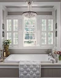 louverwood plantation shutters on transom windows in a master