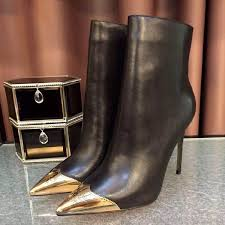 womens boots trends 2017 black and gold stiletto heels pointy toe ankle booties 2017
