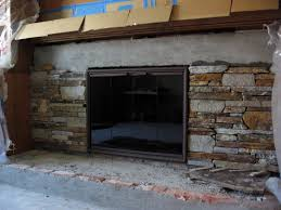 faux stone veneer fireplace interior exterior doors design photo