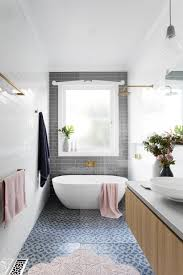 bathrooms design white bathtub with gray subway tiling and