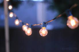 how to hang lights on house hang lighting how to hang patio string lights like a saturday