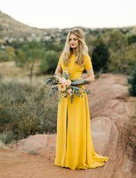 a desert road trip elopement yellow wedding dresses yellow