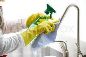 cleaning kitchen faucet cleaning the kitchen faucet stock photo colourbox