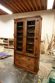 custom alder kitchen cabinet with hand forged wrought iron doors