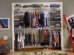 furniture reach in closet organizer design with framed picture