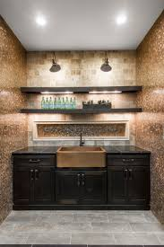 copper penny round mosaic tile backsplash and a copper farm sink