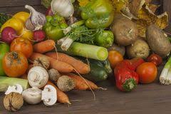various types of vegetables on an old wooden table the concept of