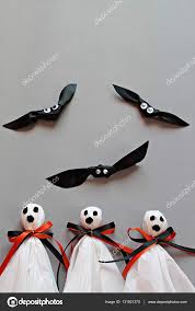 halloween orange background three halloween ghosts diy made from white tissue paper black and