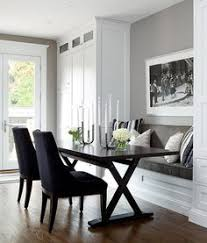 Built In Cabinets In Dining Room A Built In Banquette Is Flanked By Tall Glass Cabinets For Storing