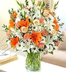 white flower centerpieces orange and white flower arrangements eatatjacknjills