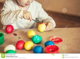 small cute baby color easter eggs on the table in colours happy