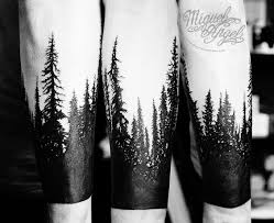 silhouette forest tattoo on arm by miguel angel