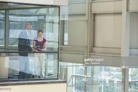 digital window business people using digital tablet near office window stock