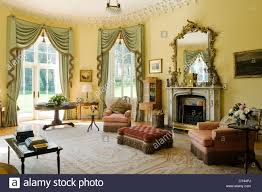 Pale Green Fringed Curtains In Yellow Drawing Room With Gilt