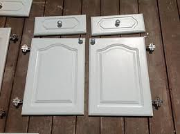 white kitchen cabinets with cathedral doors faux drawer fronts on built in bathroom cabinet doors built