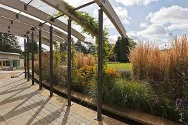 landscape design cotswolds contemporary arched pergola over