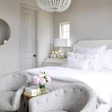dove gray velvet tufted bed with white and gold hotel bedding