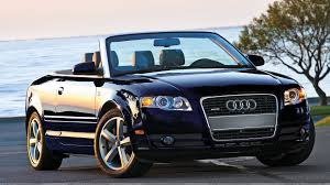 black audi convertible audi a4 cabriolet in shine black front pose near sea side wallpaper
