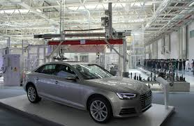 volkswagen audi vw audi may face higher costs to resolve emissions issues wsj