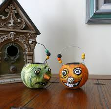 that artist woman little papier mache pumpkins