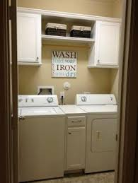 Laundry Room Cabinets With Hanging Rod Cabinet Between Washer And Dryer Closet Rod For Hanging Up
