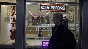 new york dec 6 2015 body piercing and tattoo shop store front