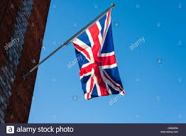 Johns Flags Riverside English National Flag Flying From The Church Clock Tower Of St