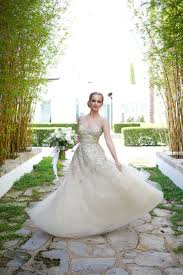wedding dresses photos bride twirling in champagne colored gown