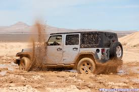 white jeep stuck in mud images of stuck in her jeep sc