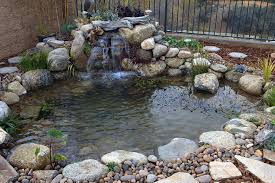 garden ponds and waterfalls designs with stone as main element