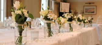 wedding flowers jam jars ideas for your top table flower arrangement botanics