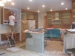 How To Refinish Kitchen Cabinets With Paint The Thrifty Home Kitchen Remodel Painting Cabinets