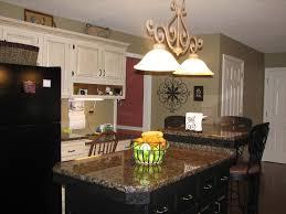 blue kitchen cabinets brown granite black island with baltic brown granite kitchen decor
