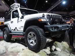 first jeep wrangler 2018 jeep wrangler jl starts at 26 995 how much did it improve