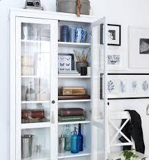 ikea hemnes glass door cabinet bookcase pretty things stored in ikea hemnes glass door cabinet