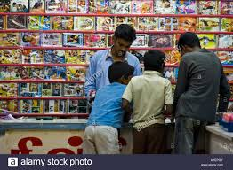 boys shopping for dvd movies and music at a shop in thanjavur