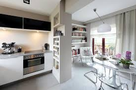 open kitchen with transparent cantilever chairs at the dining