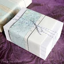 pre wrapped gift box envelopes packaged in nautical chart scraps and striped twine