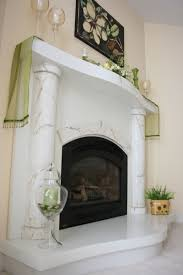 white concrete fireplace surround with marbled columns truecrete