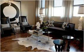 interior glamorous living room decor with cowhide rugs and black