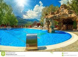 beautiful swimming pool with bar and waterfall stock photo
