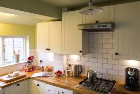 simple subway tile backsplash with modern stove and oven also