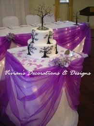 how to use tulle to decorate a table photo via purple wedding decorations purple wedding and wedding