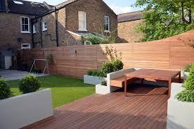 modern garden design artificial grass raised beds hardwood decking