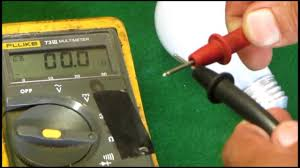 using a multimeter to check a light bulb