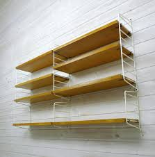 ash wall shelving system by nisse strinning for string design ab